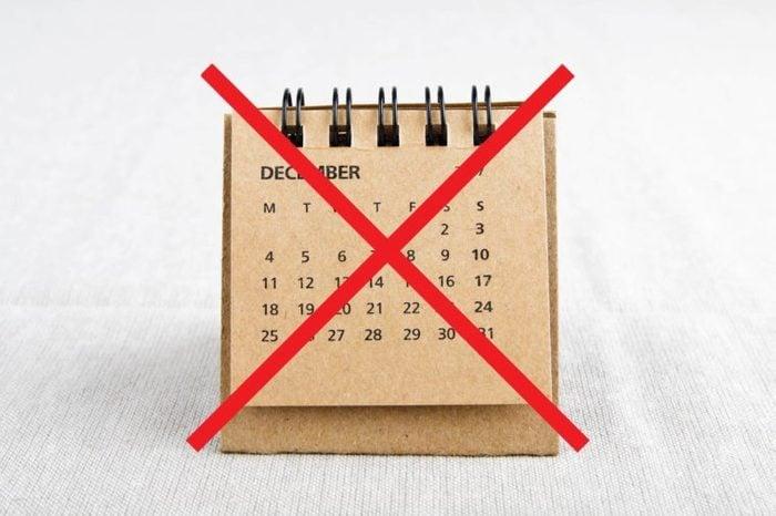 Desk calendar with an X through it.