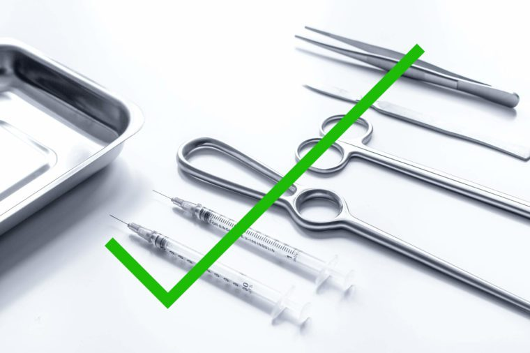 Surgical tools with a check mark through it.