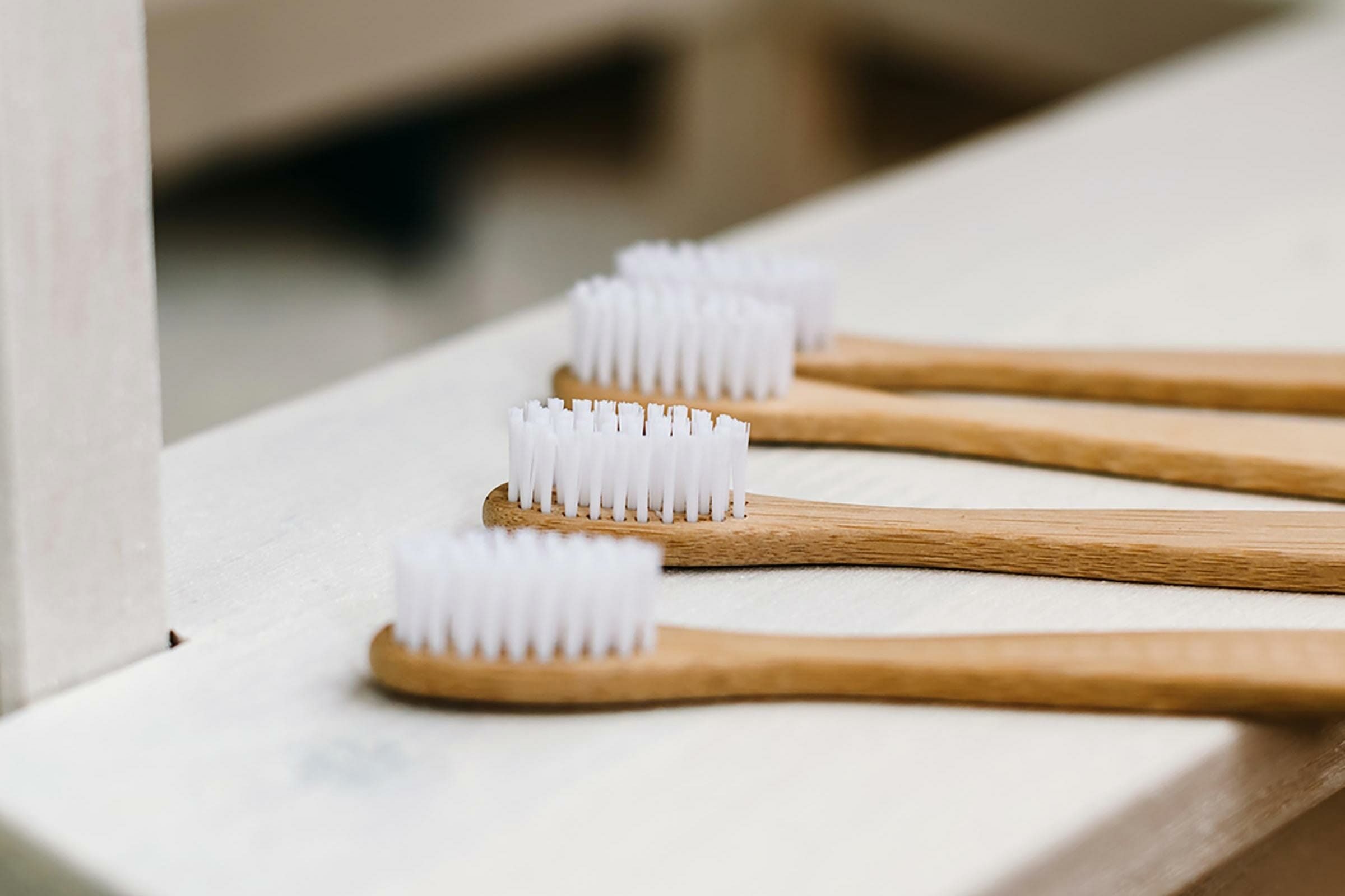 wooden toothbrushes with white bristles