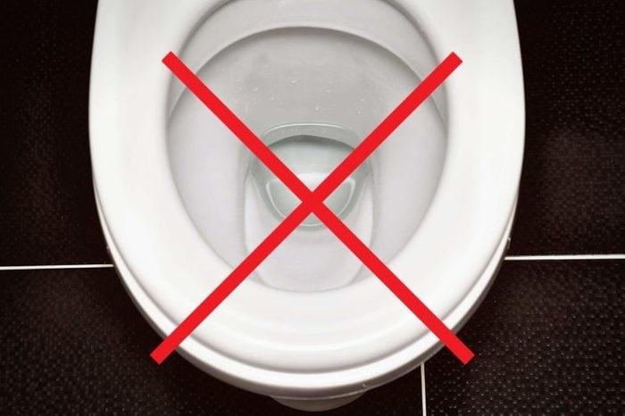 Toilet bowl with an X through it.