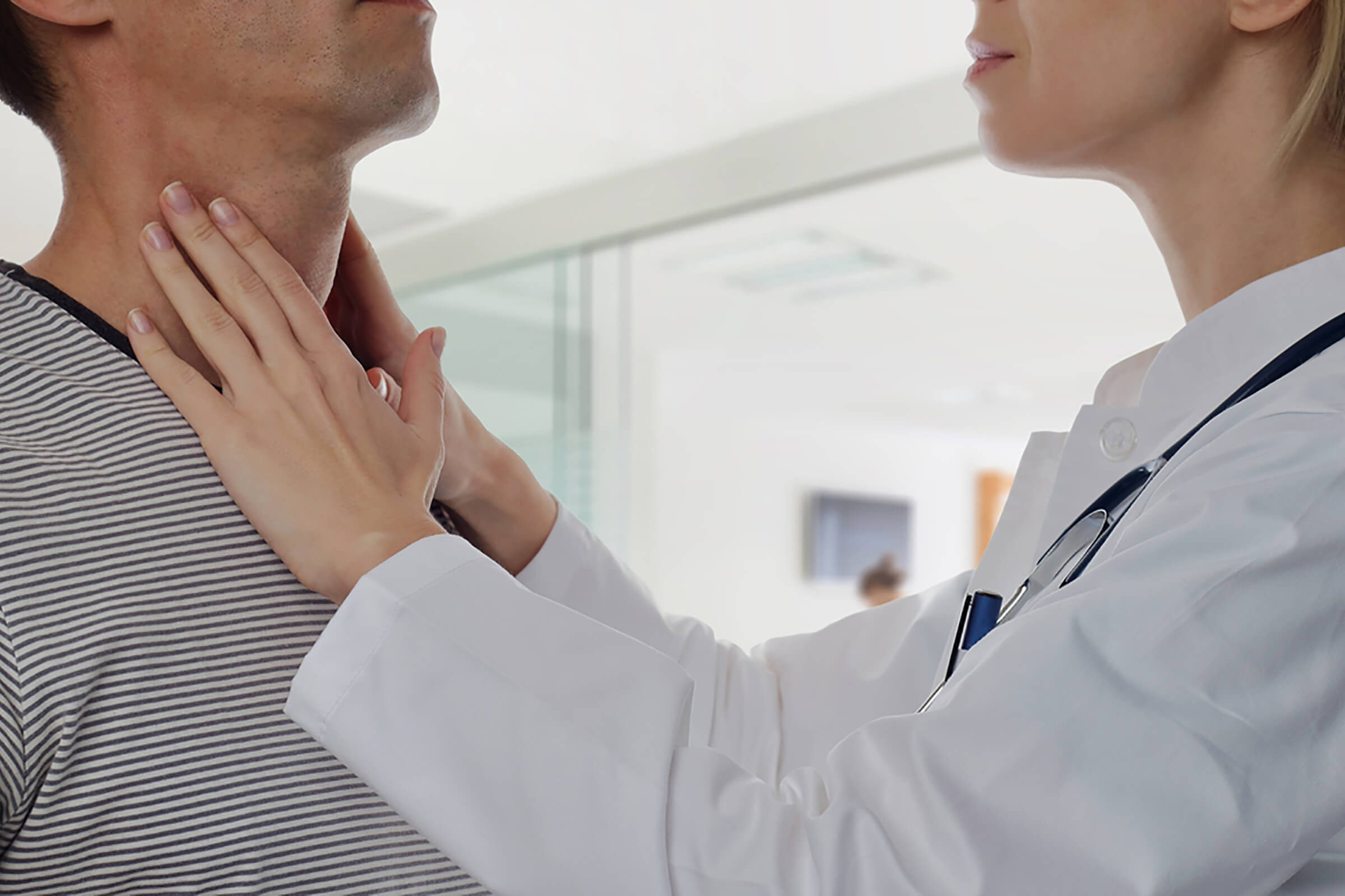 Hashimoto disease, doctor feeling patient's thyroid