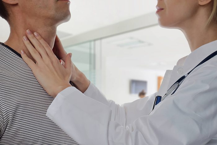 Hashimoto disease, doctor feeling patient's thyroid