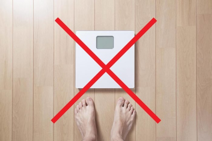 Person stepping on a scale with an X through it.