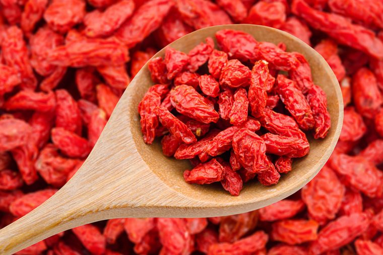 Goji berries on a wooden spoon