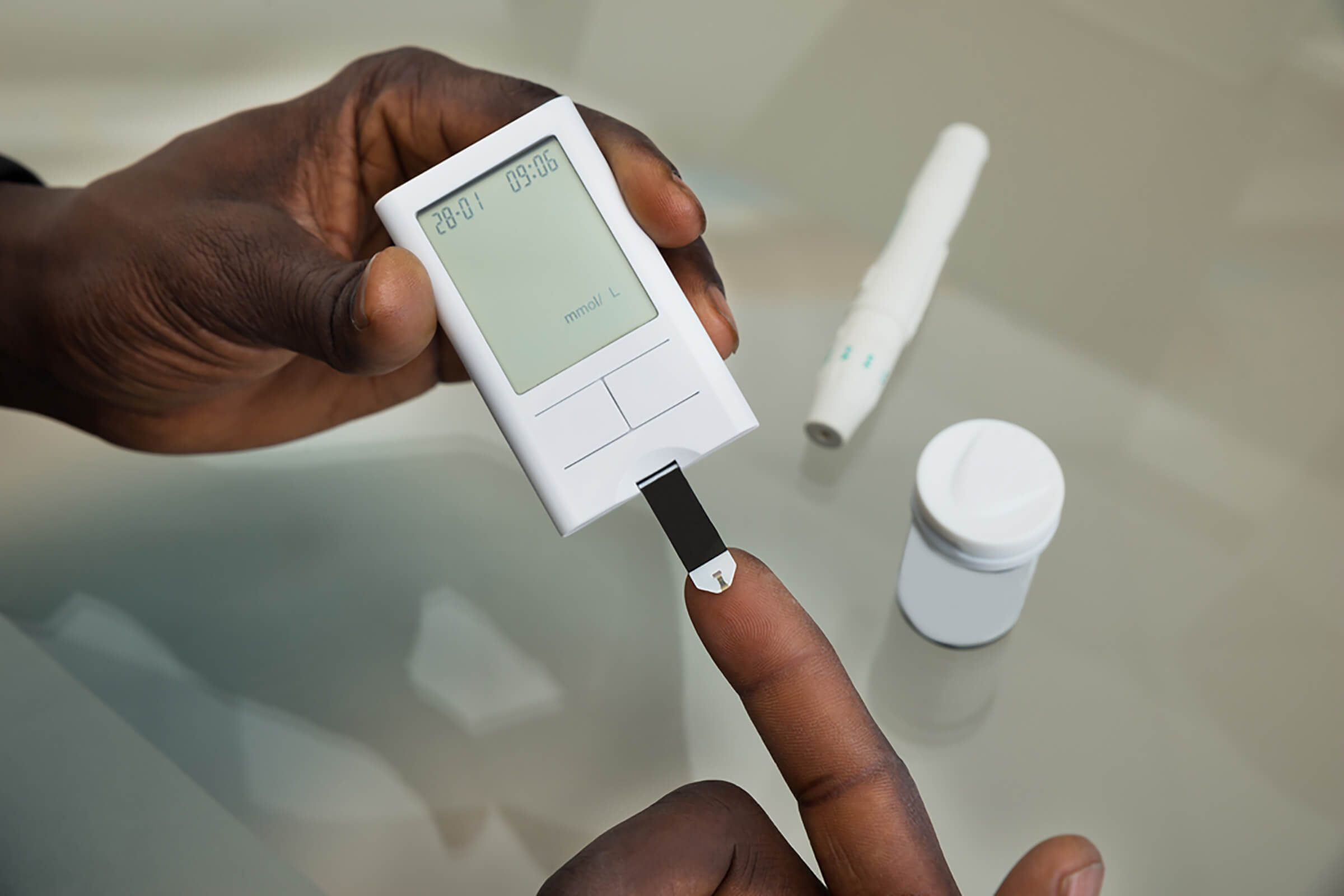 checking blood glucose with finger prick