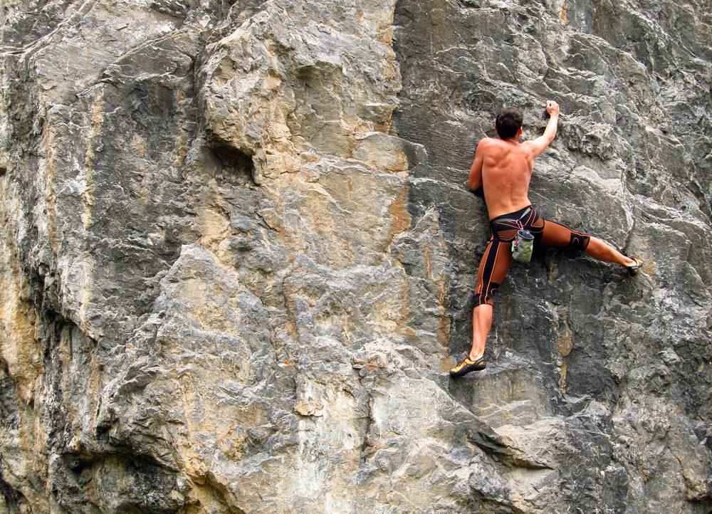 person rockclimbing