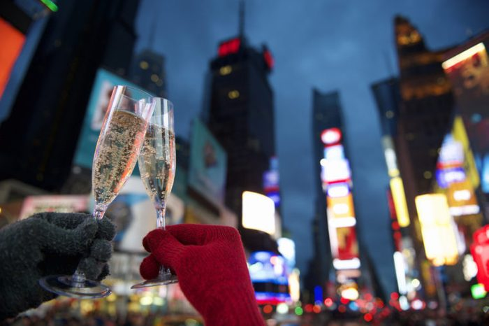 Happy New Year champagne toast couple in Times Square New York City