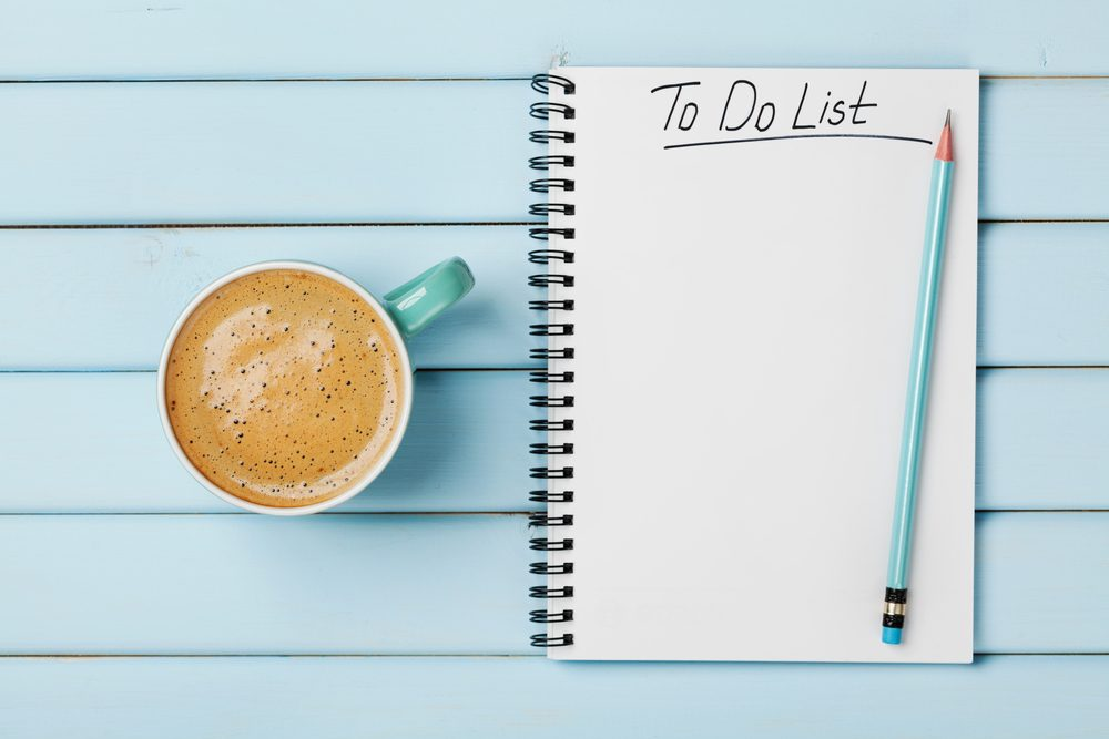 Coffee cup and notebook with to do list