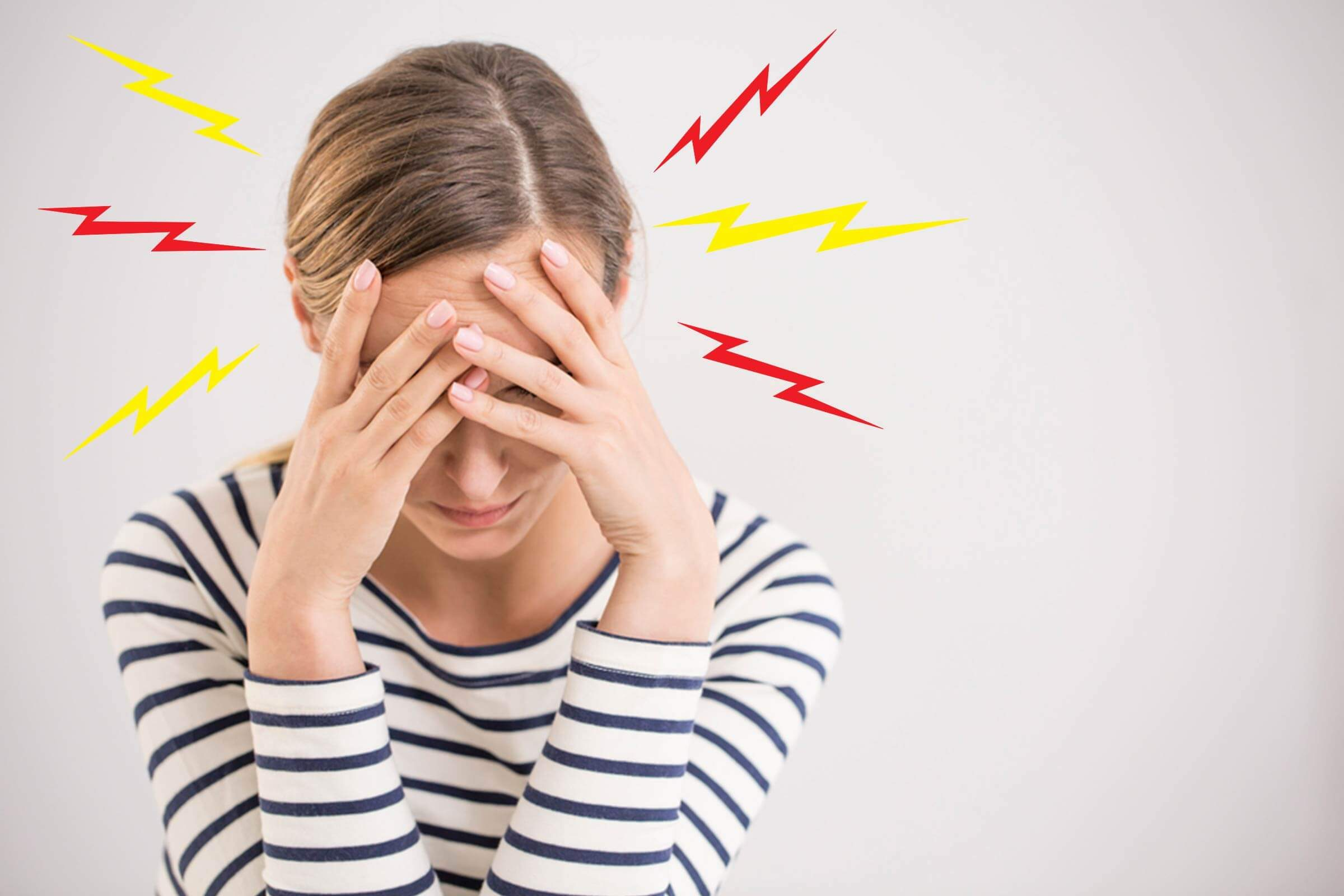 woman with throbbing migraine headache