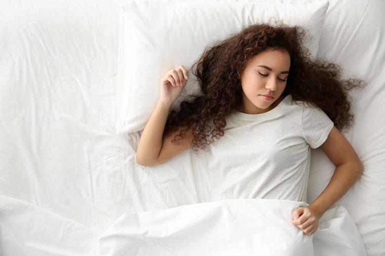 Girl sleeping on her back