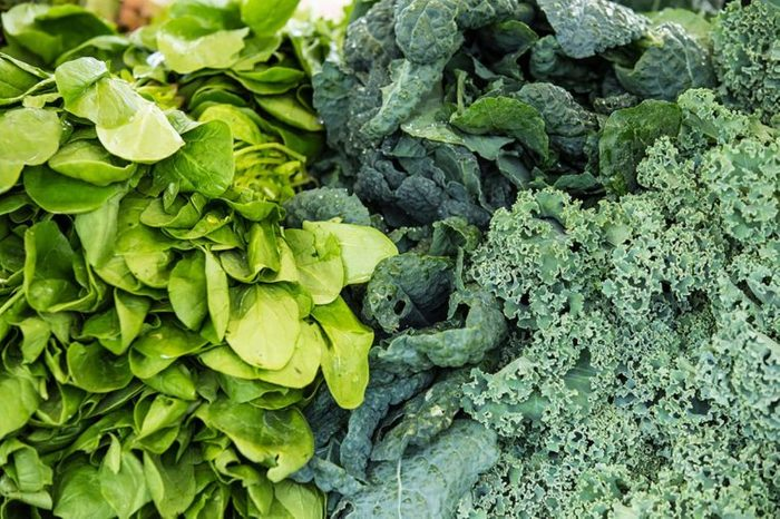 piles of different dark leafy greens, such as kale and chard