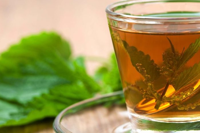 glass mug of nettle tea