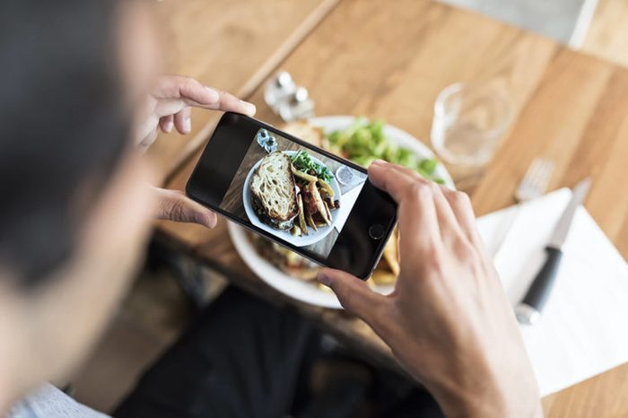 a person taking a picture of their meal with a smartphone