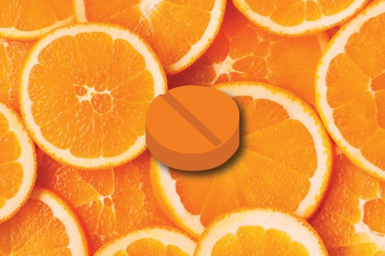 Illustration of a vitamin C tablet on an orange slice background.