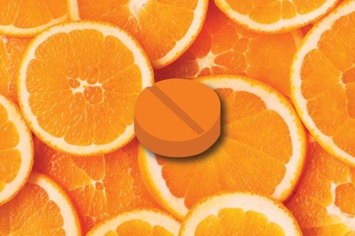 Illustration of a vitamin C tablet on an orange slice background.