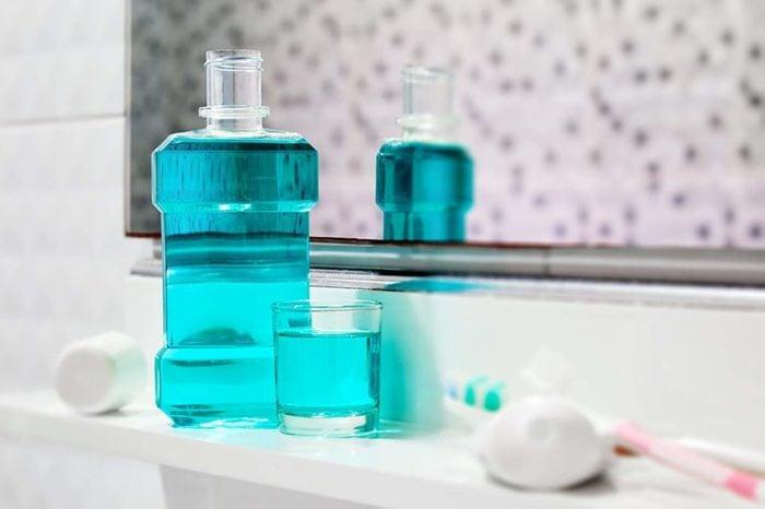 Mouthwash on a bathroom shelf