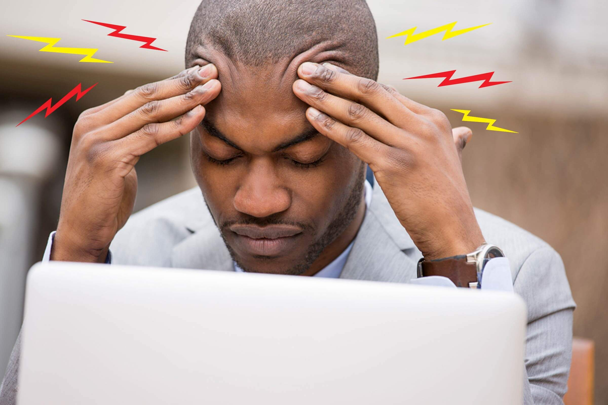 man at laptop with headache