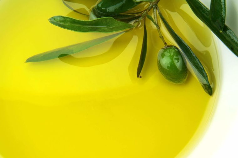 dish of olive oil with olive