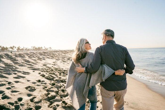 couple taking a romantic walk on the beach