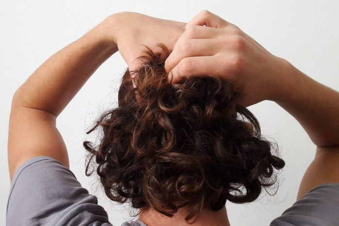 rear view of man touching his hair