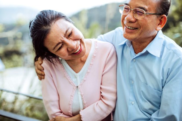senior couple smiling and laughing together