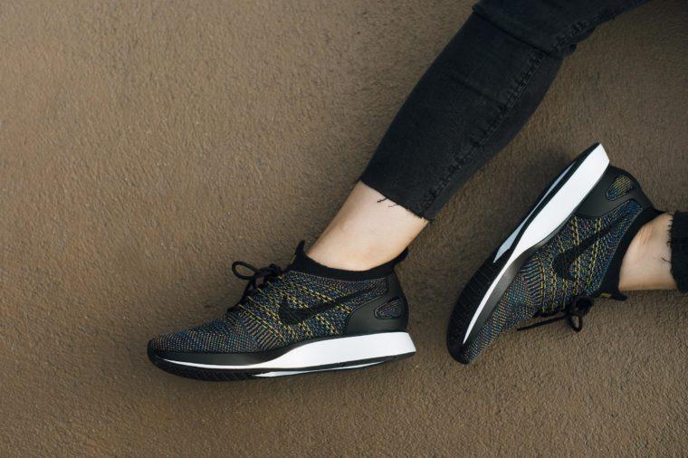 Woman's legs clad in leggings and sneakers