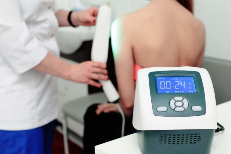 Woman receiving phototherapy treatment.