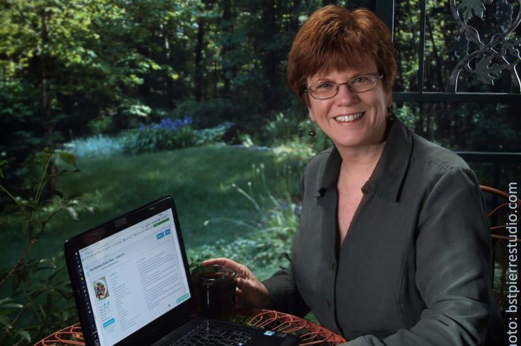 Bonnie St. Pierre sitting at a computer outdoors