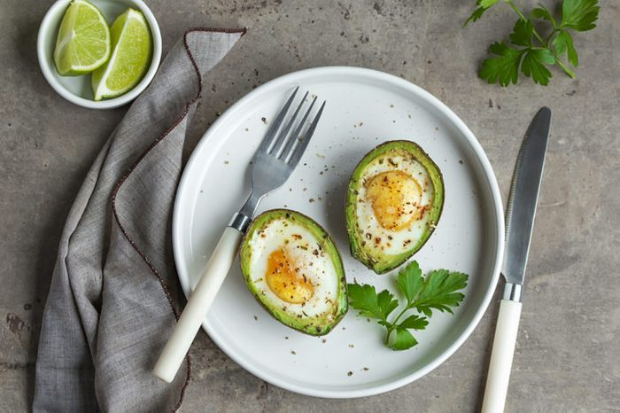 Two eggs baked into avocado halves.