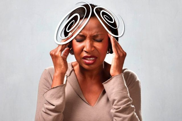black woman pressing against her temples