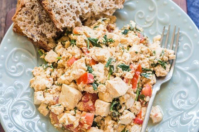 Tofu scrambled eggs and a side of multigrain bread.