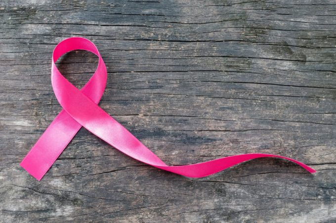 Pink ribbon breast cancer awareness symbolic bow color raising support on people living with women's breast tumor illness (bow isolated with clipping path)