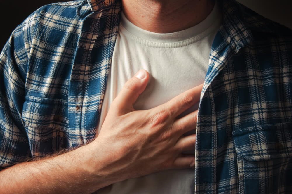 Man suffering from severe chest pain.