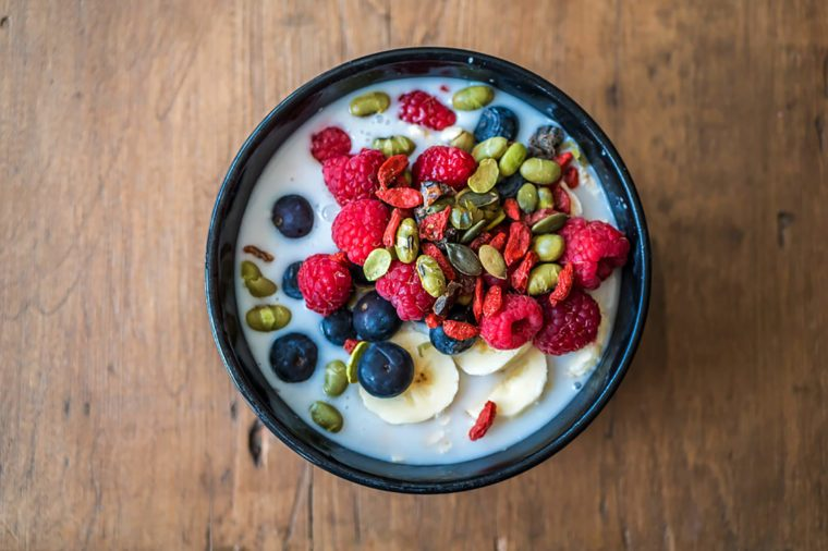 Overnight oats topped with fruit and seeds.