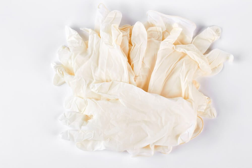 Pile of white medical gloves
