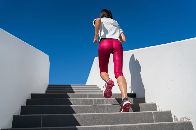 woman-running-up-stairs