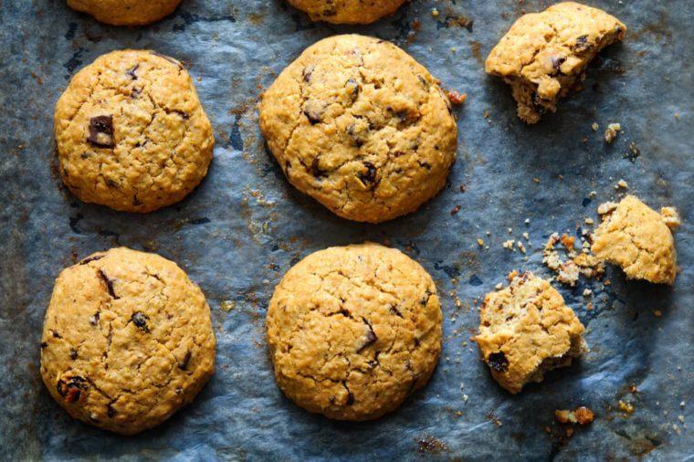 Freshly baked oat raisin cookies on baking paper