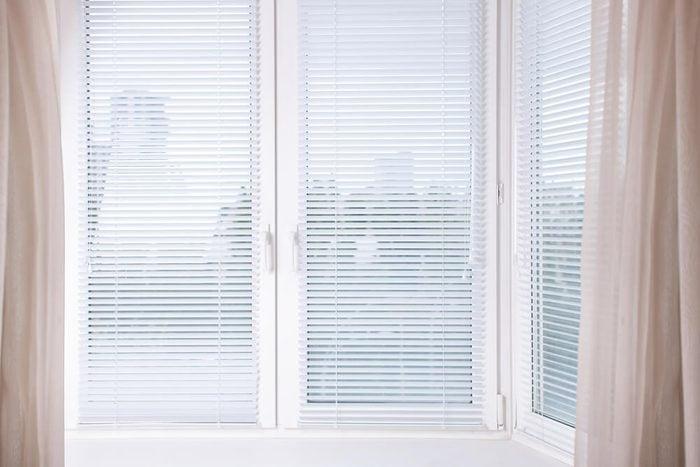 Horizontal image white Window with Venetian Blinds, Designer Blinds around the edges