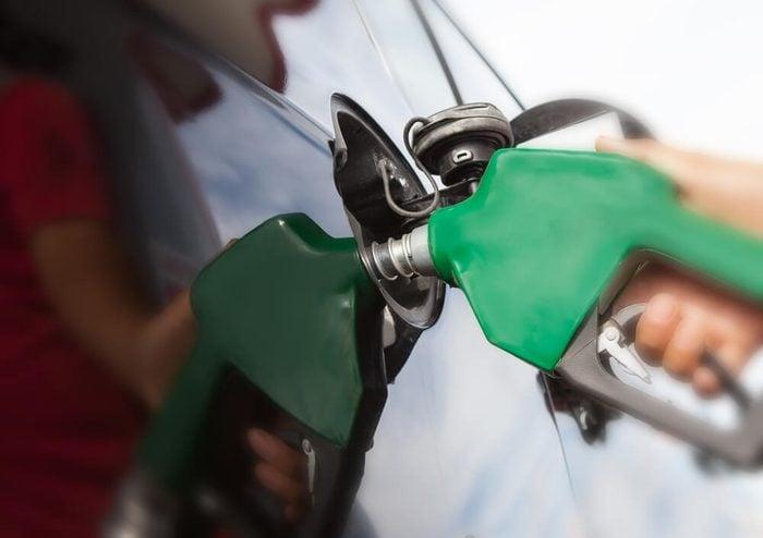 gas pump and car