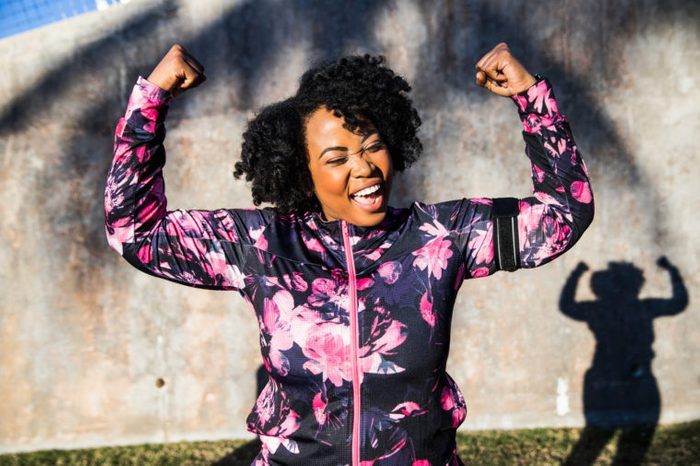 happy woman accomplishing her goals