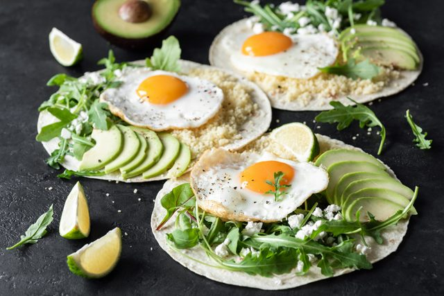 healthy breakfast tacos with eggs and avocados and greens