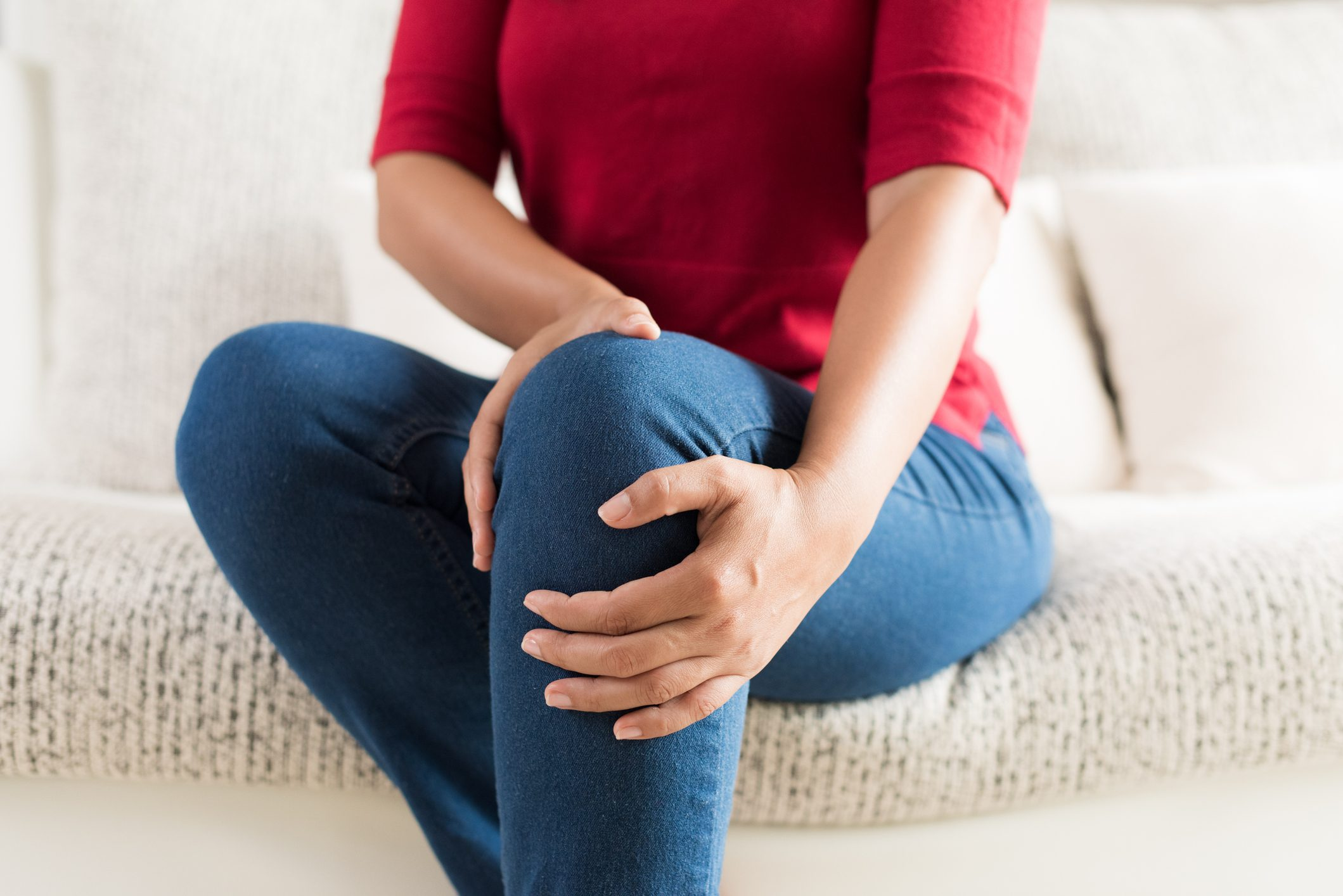close up of woman holding knee area