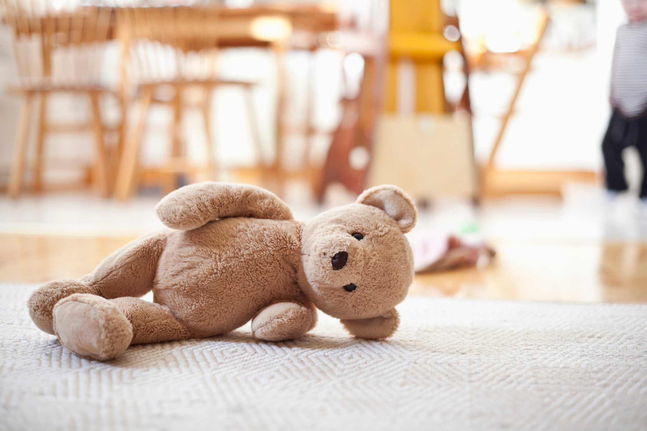 stuffed teddy bear toy on ground of home
