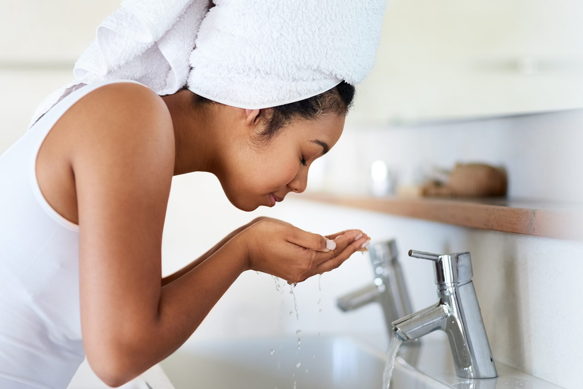 woman washing her face after taking a shower