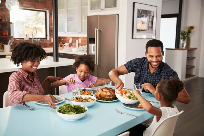 family enjoying a meal at home together