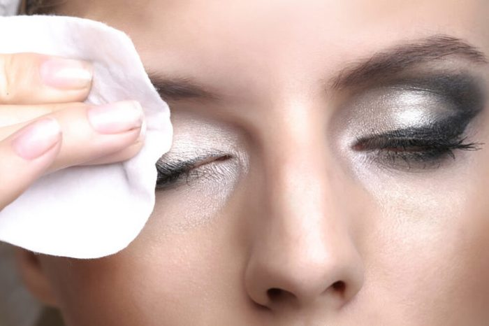 Removing makeup with cotton pad