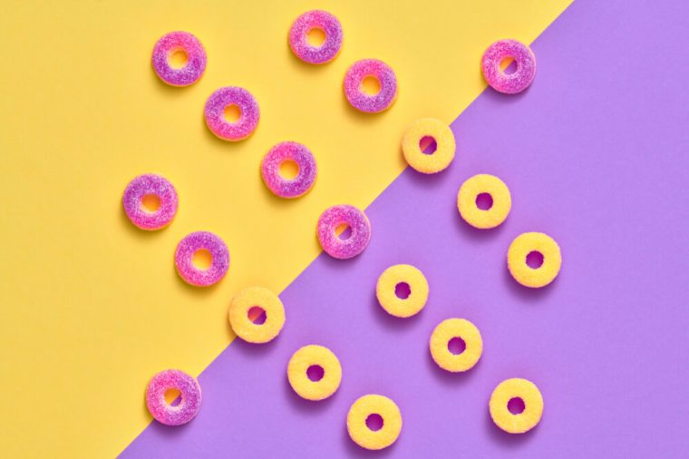 Gummy Candies background, Sweets. Creative Flat lay. Summer Party, Purple Birthday Layout. Bright Colorful. Fun Trendy fashion Style. Minimal. Pop Art