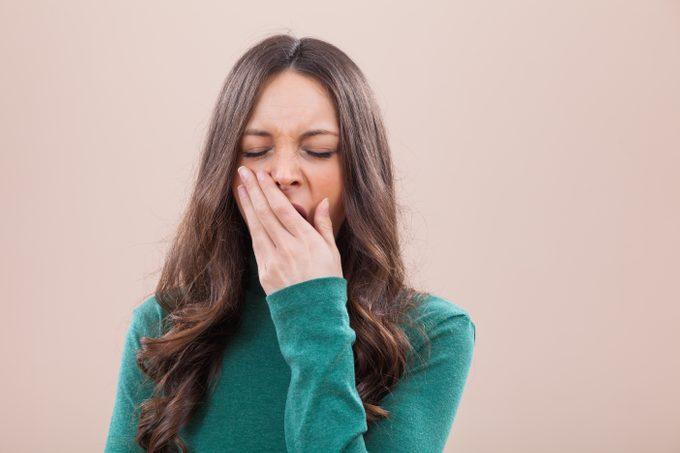 portrait woman yawning tired