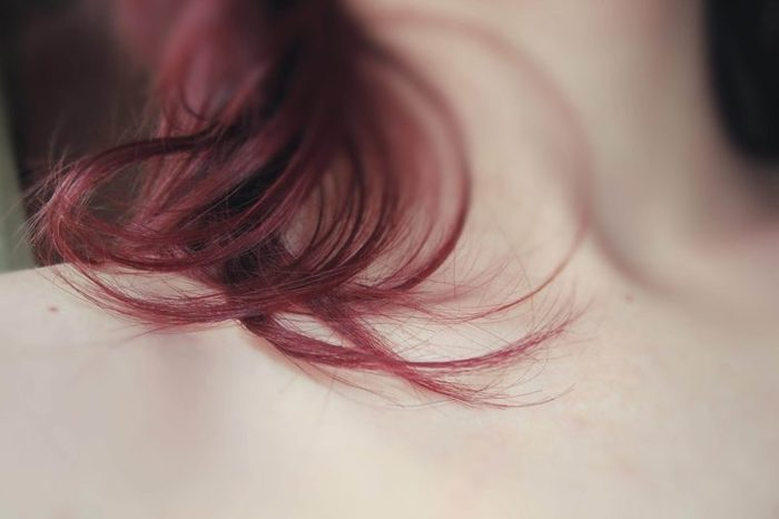 closeup of a woman's hair draped over her neck and collarbone