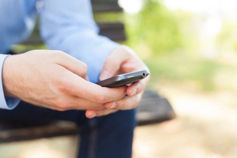 Man texting on smartphone